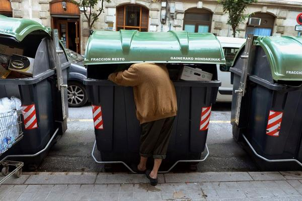bask woman sorting garbage